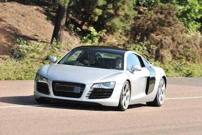 Audi R8 Thrill the beautiful step sister of the stunning lamborghini gallardo, the audi r8 with a 4.2 litre v8 engine, and a top speed of 187mph might be half the price but with a waiting list that reads like a fant http://www.MightGet.com/january-2017-12/audi-r8-thrill.asp