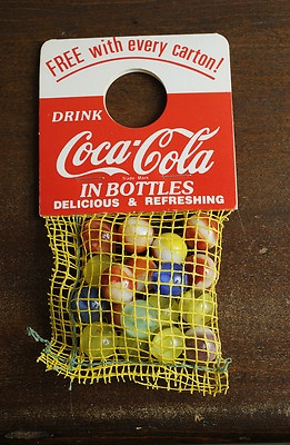 *COCA-COLA ~ marbles promotion - free bag of marbles hung on neck of one bottle in each carton, circa 1950s-60s.