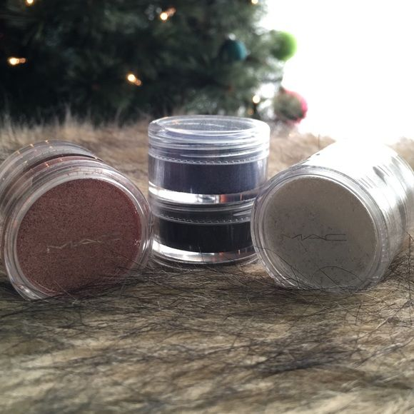 Authentic MAC glitter eyeshadow! Each one contains two colors. 1. Pink and cream color 2. Blue and black 3. White and sliver. These have never been used and are like brand new! Makeup Eyeshadow