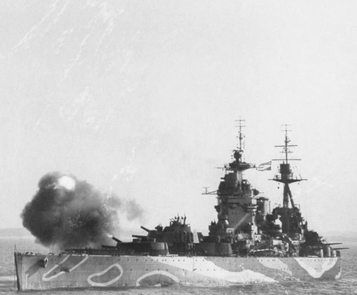 Battleship HMS Rodney fires its guns off the coast of Normandy, supporting the D-Day invasion.