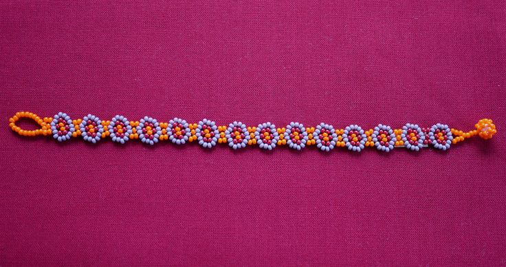 MEXICAN LITTLE FLOWERS BEADED BRACELET - ORANGE & LILAC   ★ Mexican beaded bracelet, with a flower path in orange, lilac, and red. It's simple to wear; it just easily rolls over your hand and is very comfortable. ★ This beaded work is made by Mexican families. ★ You can combine it with various styles!
