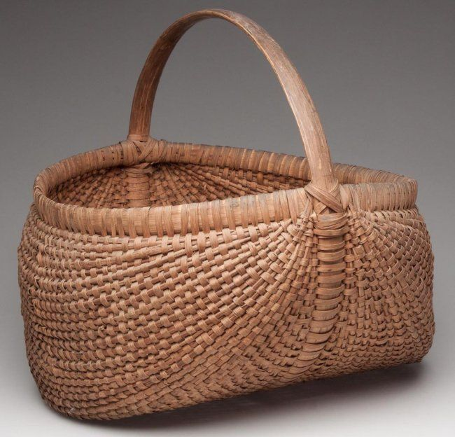 """SHENANDOAH VALLEY OF VIRGINIA RIB-TYPE WOVEN SPLINT BASKET, white oak, large kidney form with wrapped rim and arched handle. Original natural surface with excellent patina. Probably Augusta Co., VA. First quarter 20th century. 14 1/2"""" HOA, 8"""" H rim, 14 3/4"""" x 15"""" rim."""