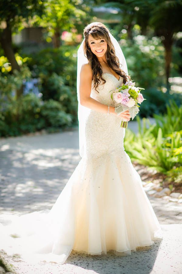 Fit and flare sparkly sweetheart wedding dress paired with a veil (Julie Nicole Photography)