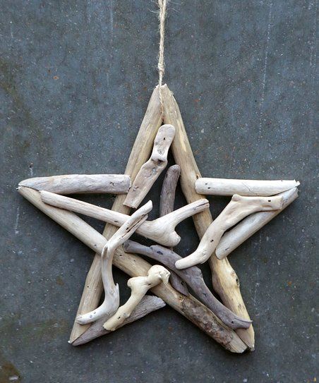 Bring a rustic ocean quality to your décor with this charming driftwood star ornament.