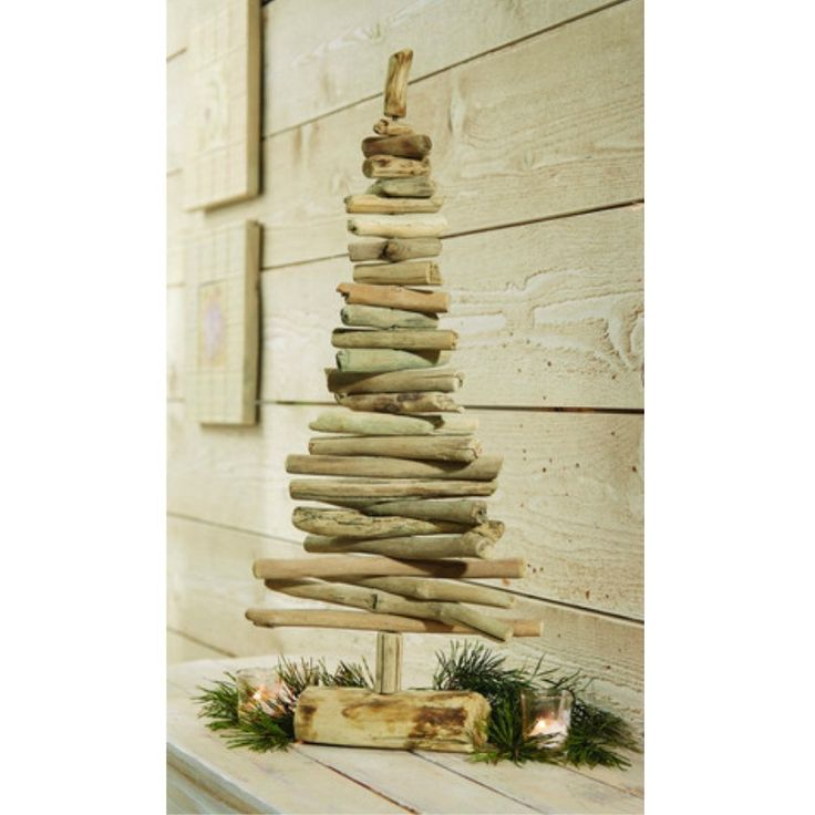 Stunning, modern hand-crafted driftwood Christmas tree features adjustable wood…