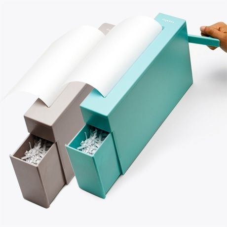 manual shredder -- cute and quiet, but probably annoying for those with large volumes of paper to shred.