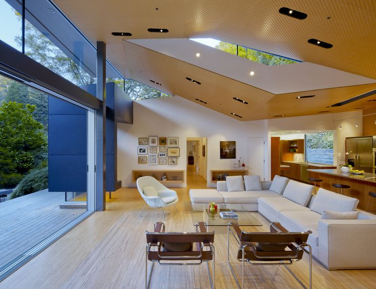 A view of the living room with folded ceiling and a clerestory window to bring light into a loft-like space. Griffin Enright Architects