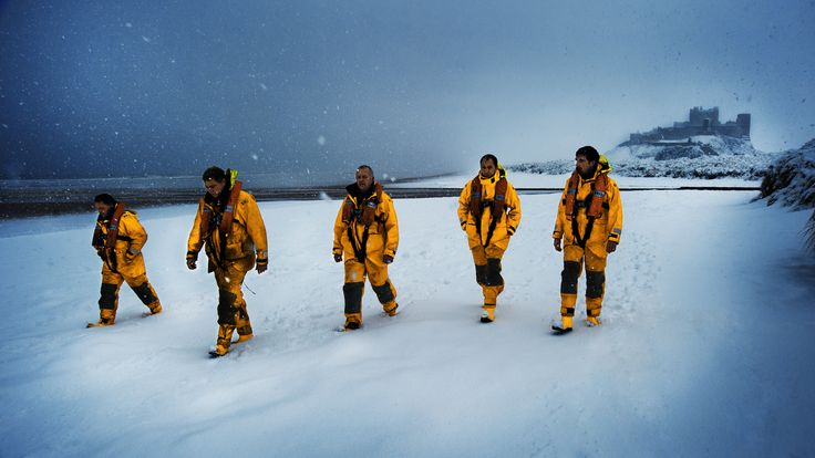 The Seahouses volunteer crew  returning through the snow near Bamburgh Castle in Northumberland after a search exercise on the beach. ©Nigel Millard/RNLI