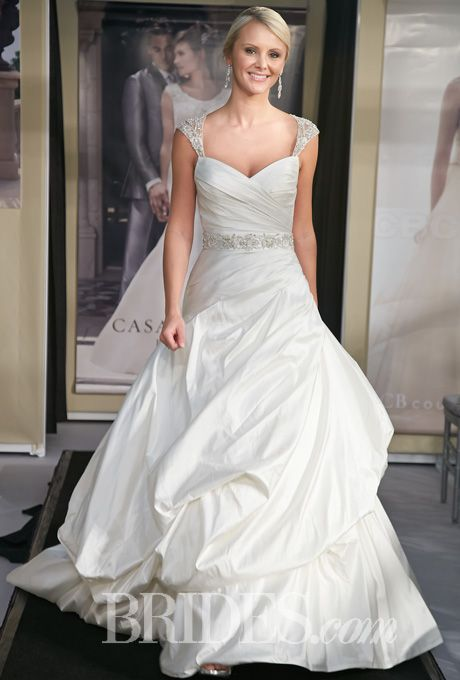 Me likey Style B084, sleeveless silk shantung A-line wedding dress with a sweetheart neckline, beaded cap sleeves, and a billowy pick-up skirt