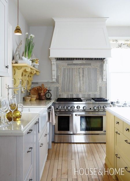 Salvaged cabinets and high-end appliances give this space an authentic country air.The dramatic stove hood highlights this awesome professional range.