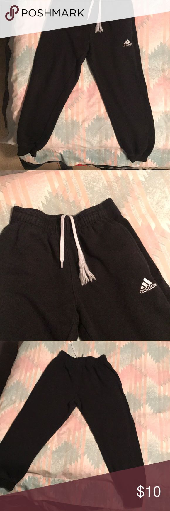Boys black adidas joggers Boys Black Adidas Joggers. The only thing wrong with the Joggers is the string as shown in picture. Otherwise the Joggers are in great condition. adidas Bottoms Sweatpants & Joggers