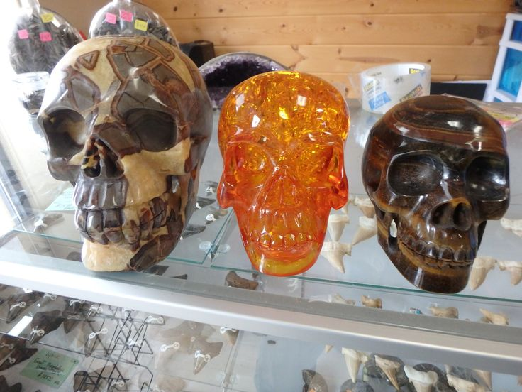 Some of the many gemstone skulls we have for sale!