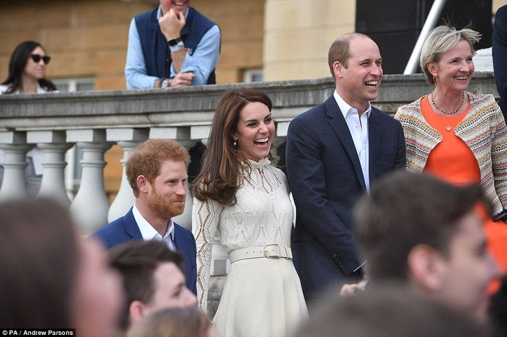 The royal trio were in high spirits when they posed together on the steps of Buckingham Palace during the Party at the Palace