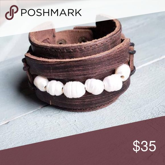 """Distressed Leather Cuff with Freshwater Pearls Each hand-distressed cuff is made with genuine leather and features two adjustable snaps. Entire length of bracelet is 2"""" by 9"""".  Adjusts with snaps from Approx. 7"""" to 7.5"""".  The distressed finish leather cuff features a genuine strand of freshwater pearls. This high quality, hand-crafted jewelry is made right here in Texas. These unique pieces are created by hand so no two cuffs will look the same. Expected delivery date is November 20th…"""