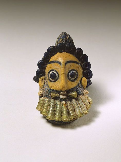 A Phoenician or Carthaginian Glass Pendant in the Form of a Bearded Head