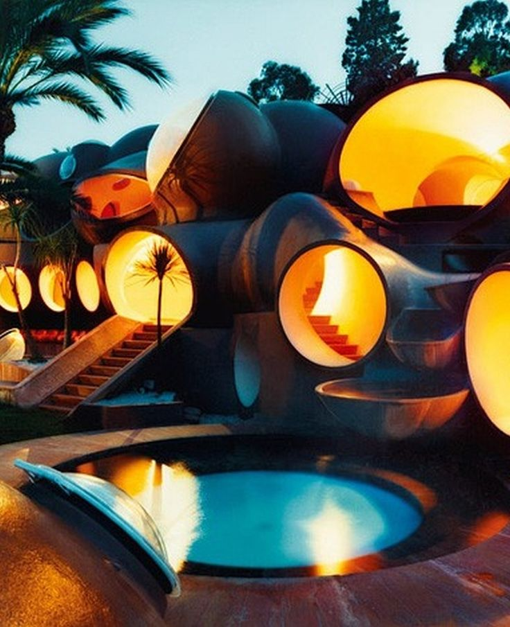 As the history says , Pierre Cardin was looking to buy a house many years ago. But nothing matched his taste . Finally he found this bubble house designed by Antti Lovag . At the beginning no one liked Lovags creation , but now its a historic monument,