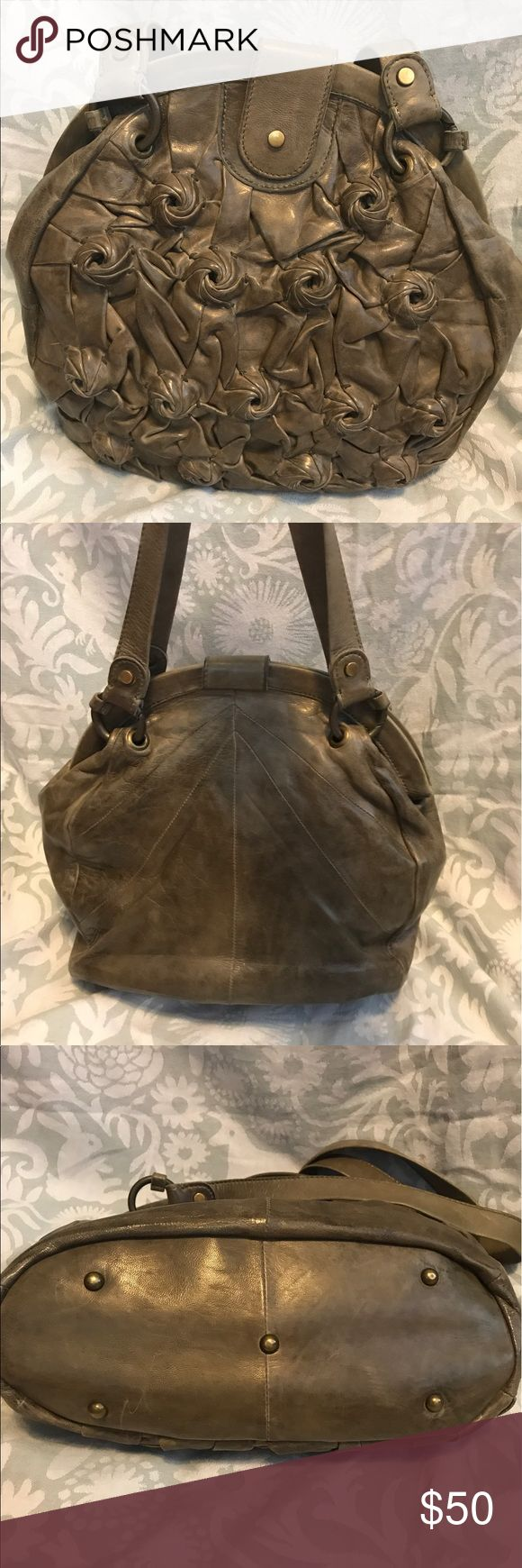 Anthropologie Henny Penny Leather Handbag Leather roses adorn the front of this gorgeous handbag from Anthropologie. Interior is in fabulous shape. I'm reposting! Anthropologie Bags Shoulder Bags