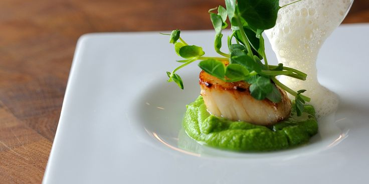 Pan-fried scallops are given an elegant treatment with peas and cumin foam in this remarkable scallops recipe by award-winning chef, Chris Horridge.