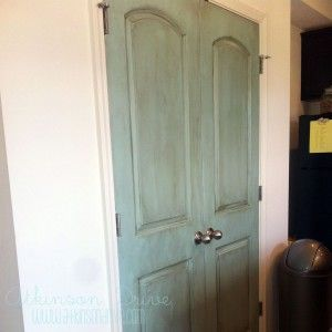 DIY Painted Pantry Doors: How to paint and distress interior doors for a pop of color.