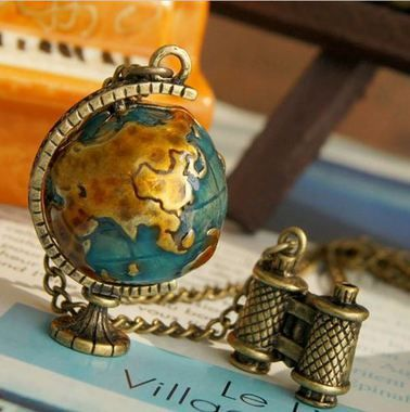 Where in the world has our Retro Globe Necklace been all of our lives?  Besides possibly sitting in the back of Miss Skibiskis's 6th grade classroom next to her fall themed sticker board.  This adorable necklace is in a Geography class of it's own!  Now, when you're stuck at work, suffering in traffic or dreaming of traveling the world... you can take your globe for a spin (it really spins!) and imagine you're exploring a sandy beach situated closely to the equator with a frosty drink in…