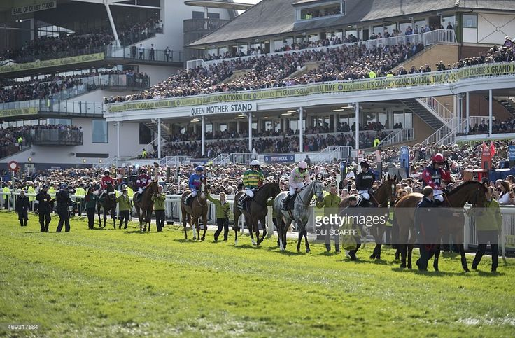 Jockeys process past the grandstands as they make their way to the start of the Grand National race on the final day of the Grand National Festival horse race meeting at Aintree Racecourse in Liverpool, Northern England on April 11, 2015. The annual three day meeting culminates in the Grand National which is run over a distance of four miles and four furlongs (7,242 metres), and is the biggest betting race in the United Kingdom.