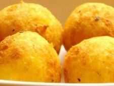 Cheeseballs or locally known as Bolita di Keshi recipe: A kids favorite snack, very easy to make and disappears rather quickly too. Great for parties and family reunions.