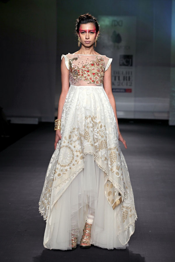//lovely embroidery on a white anarkali.
