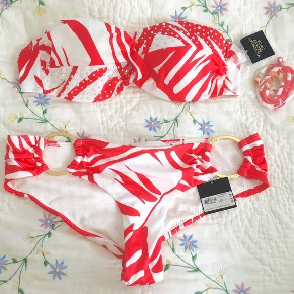 Victoria's Secret Rhinestoned Aztec Bikini Set Color: white and red Size: Various, sell options below  Beautiful embellished rhinestoned Swimwear  Padded bra  Adjustable back hook  Make a statement with this super stylish 2-piece! Victoria's Secret Swim Bikinis