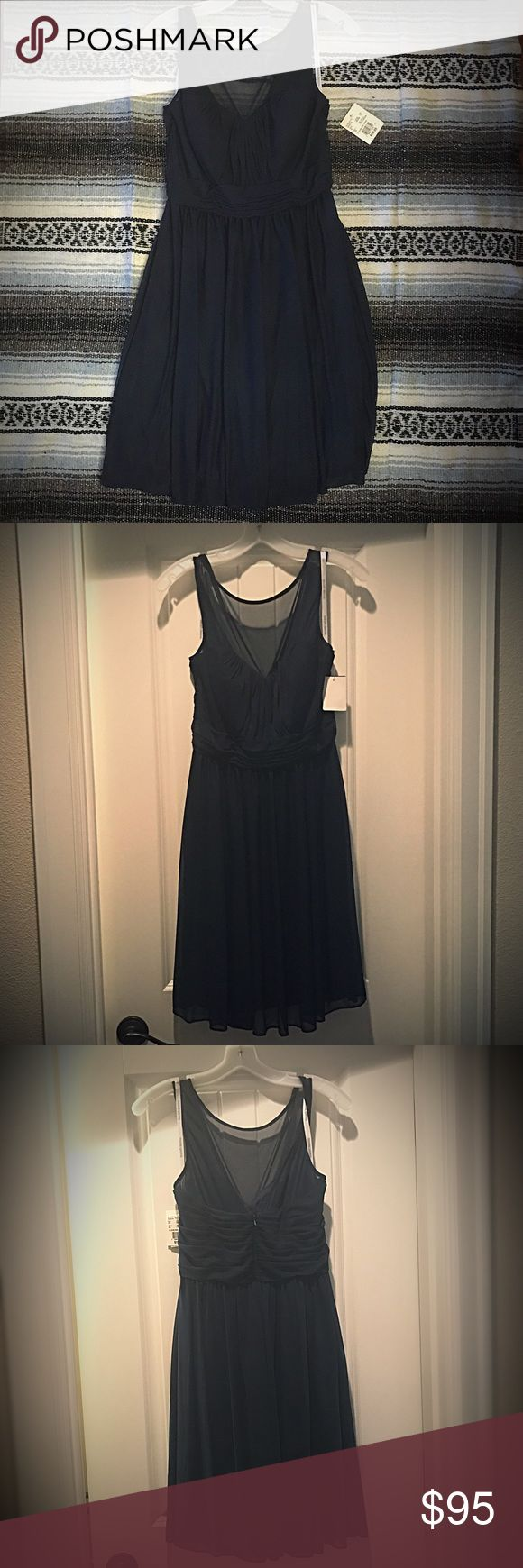 David's Bridal, never worn, marine, illusion mesh David's Bridal, never worn, marine, illusion mesh, ordered this for a wedding but we changed dresses so I won't be needing it, still comes with dress bag. Still a really cute dress 👗 David's Bridal Dresses