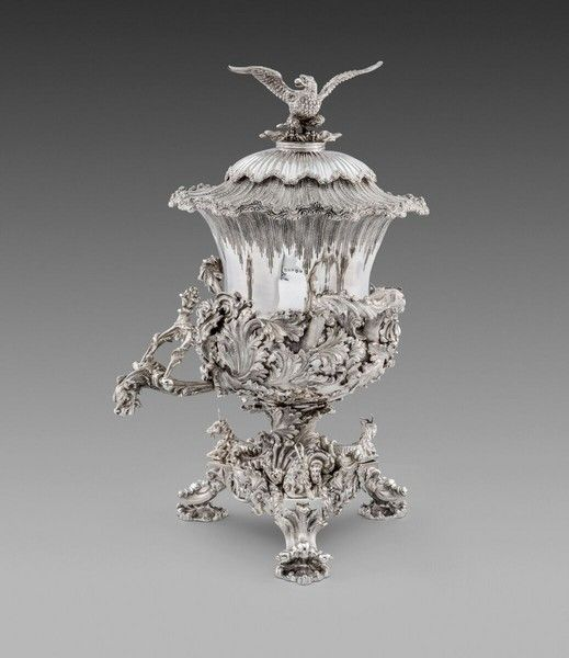 An Exceptional Irish William IV Tea Urn 1836, maker's mark of Robert Smith. Applied with high relief swirling and matted acanthus, the support with three recumbent goats, spume borders and spread-winged eagle finial. Zoom to see fabulous detail via the link