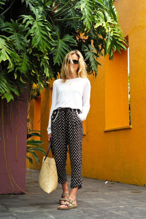 Printed pants are the most travel-friendly piece because you won't see the wrinkles from packing.