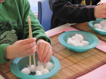 Chinese New Year Game: chopstick transfer, but use some kind of smaller food item instead of cotton balls to make it harder for older kids.