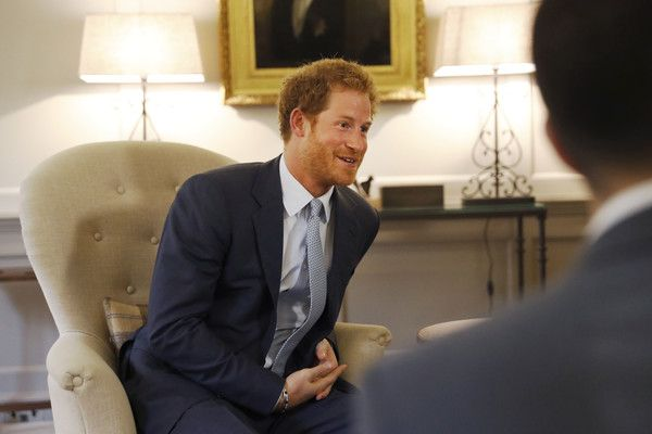 Prince Harry speaks after presenting U.S. Staff Sergeant Elizabeth Marks' gold medal to members of the medical team from Britain's Papworth Hospital at Kensington Palace on June 1, 2016 in London, England. At the 2016 Invictus Games in Orlando, U.S. Staff Sergeant Elizabeth Marks asked Prince Harry to present her 100m swimming freestyle medal to the team at Papworth Hospital, who she credits for saving her life.