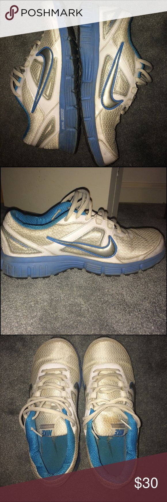 Nike Dual Fusion ST Sneakers white/light blue....very comfy and have lots of life left. in 3rd year of college and these haven't left the house once to come with me. can clean to best of my ability before shipping! Nike Shoes Athletic Shoes