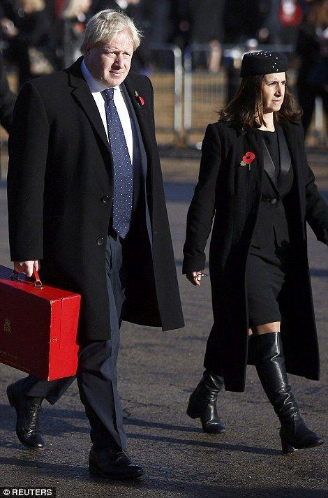 Britain's Foreign Secretary Boris JOhnson and his wife Marina walk past Horse Guards Parade