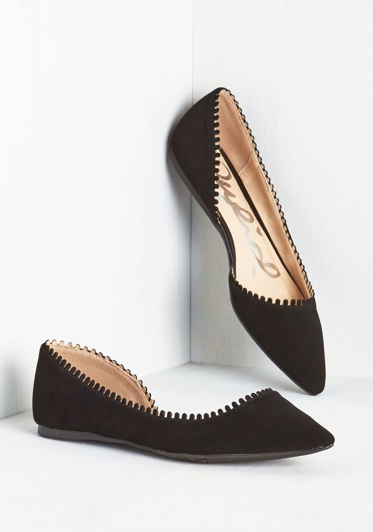 Upon sliding your toes into these matte black flats,