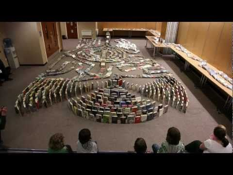 This  is a fascinating, yet somewhat disturbing video to watch as a librarian, who knows that SOMEONE is going to have to put all of those books back in place!