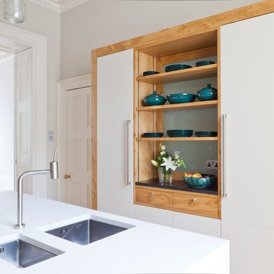 Like the white worktop and square under-mount sinks. Don't like the wood/white wall unit with open shelves.