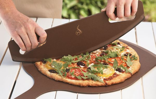 When it comes to pizza, this is cutting edge stuff. Better than the tiny pizza wheel, this phenolic paper curved guillotine slices pizza quickly, cleanly and evenly, but has no sharp edges that will damage your counter or get dull. It's also dishwasher-safe. Get ready to rock.
