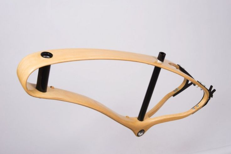 Wooden bike with unibody frame made by Jan. Description from bikejan.com. I searched for this on bing.com/images