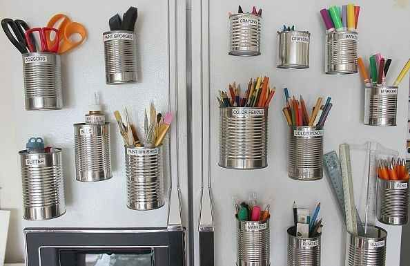 Tuck Art Supplies into Salvaged Tin Cans.   19 Insanely Clever Organizing Hacks