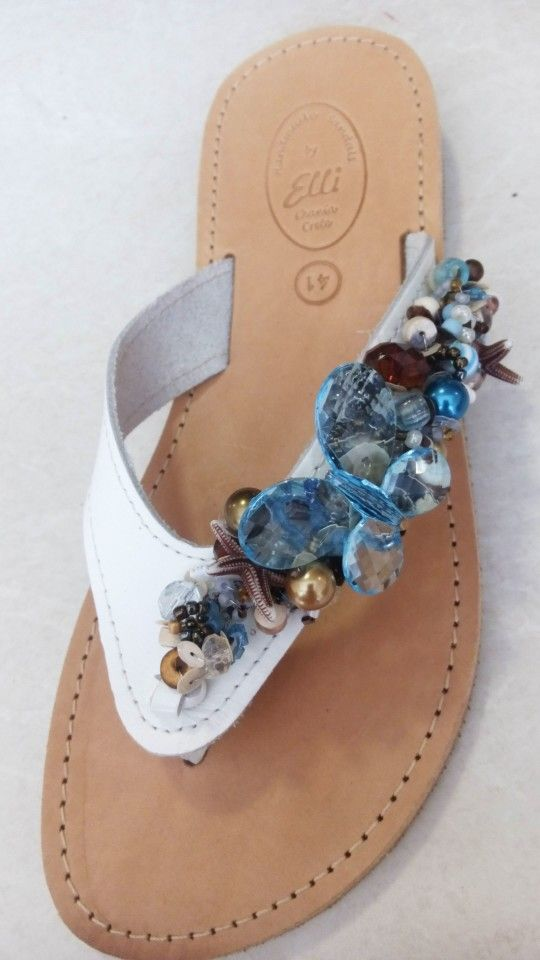 Handmade white leather sandals decorated with pearls designed by Elli lyraraki