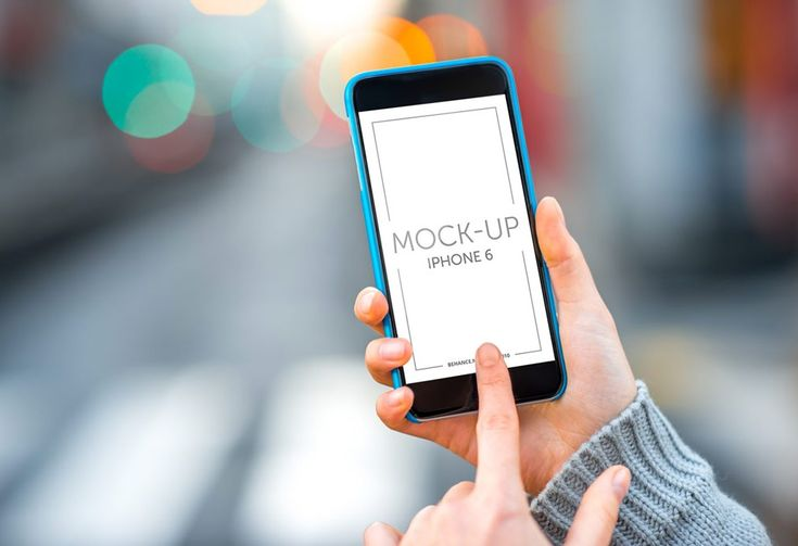 Touching an iPhone outdoors Mockup