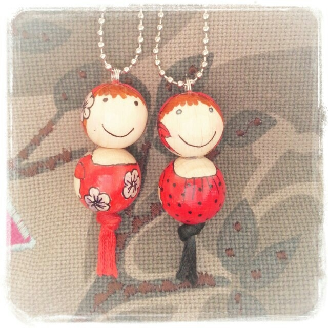 Wooden bead doll pendent.
