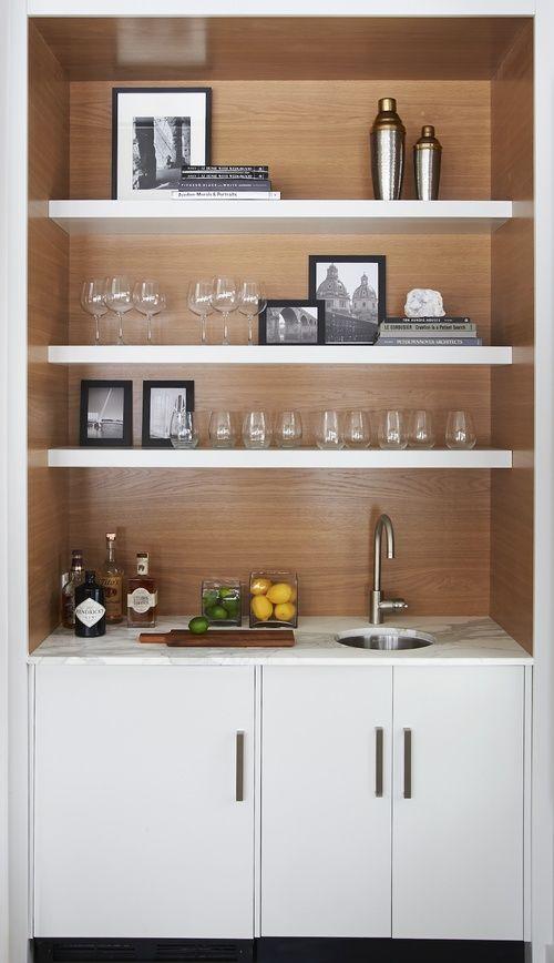https://i.pinimg.com/736x/45/27/97/452797a5cab77e6996548dd4eec07e54--bars-in-basement-glass-shelves.jpg