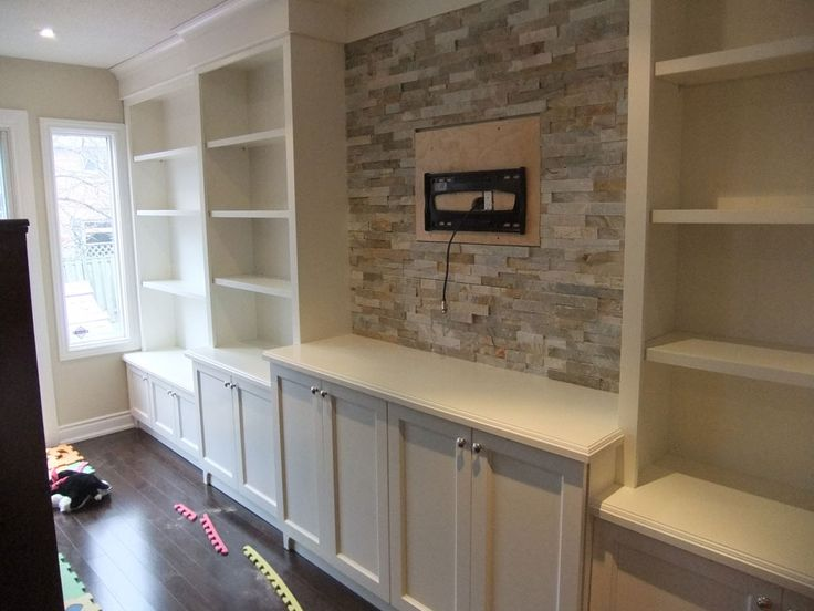 family room built in with stone feature behind television