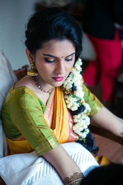 South Indian Makeup and Hairstyling - South Indian Bride in a Green and Yellow Saree with Floral Braid and Soft Pink Makeup | WedMeGood  #wedmegood #indianbride #southindianbride #southindian #makeup #hairstyle #southindianmakeup
