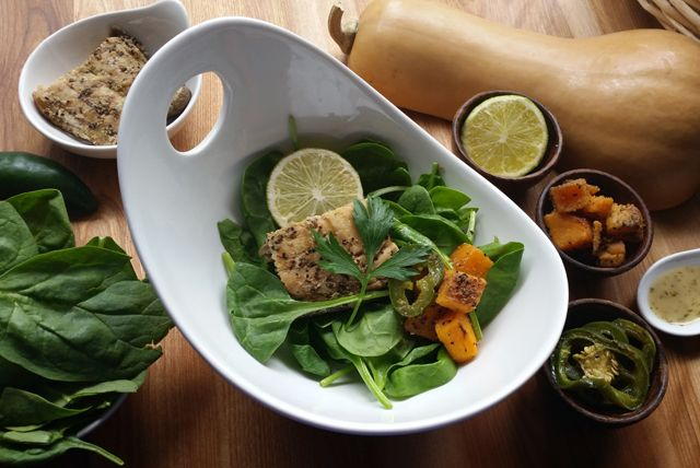 Marinated salmon and roasted butternut squash give this bistro-style spinach salad terrific flavor.