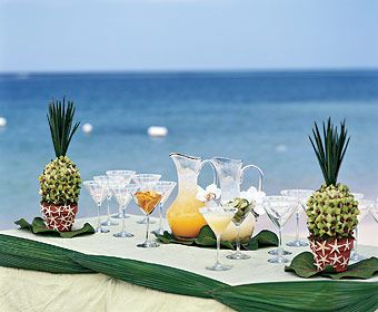 "Brides.com: Destination Wedding Style: Jamaica. Cool Down  The event is smaller than his celeb bashes, but the effect is as dramatic as any Bailey production, with shell-encrusted vases, and ""pineapples"" crafted from flowers. Pitchers of margaritas and mimosas wait to refresh guests; the fantasy pineapples were made with dendrobium orchids and palm fronds, while mini starfish were glued to the terra-cotta pots."