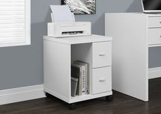 White Hollow-Core 2 Drawer Computer Stand On Castors.  This Mobile Stand Is The Perfect Combination Of Contemporary Design And Functionality. With Its Sleek Lines And Thick Panels, It Will Add Modern Appeal To Any Home Office. Stand Alone Or Paired With Matching Desk And Bookshelf For Optimal Organization. Features Two Drawers For Added Storage And An Open Storage Compartment For Cpu Or Accessories. An Ideal Place For A Printer Or Scanner Or Other Computer Hardware..  Contemporary Style....